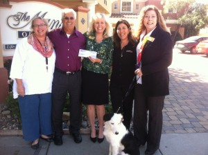 Manse on Marsh Marketing Director Jane Lefebre, Senior Nutrition Program Executive Director Elias Nimeh, Manse on Marsh Executive Director Julie Ballo, ASCPA Attorney Jill Buckley, Age Alliance CEO Deborah Bayles, and Molly the dog